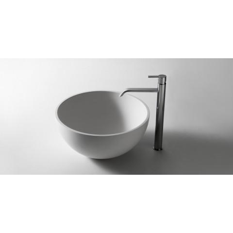 Lavabo tondo soprapiano in Flumood modello Urnamood di Antonio Lupi